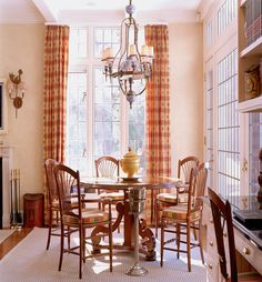 A great chandelier balances out the high ceiling in this light and airy French Provincial style dining room. EuroLuxAntiques.com   Portfolio: French Provincial DDLK | Stephanie Stokes, Inc.