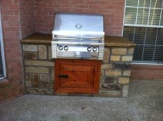 Groundscape, a Fort Worth Landscape Company, rocked in a grill with custom made cedar door. Sprinkler System Repair, Cedar Door, Flower Bed Edging, Drainage Solutions, Landscape Services, Landscaping Company, Outdoor Kitchens, Outdoor Living Areas, Fort Worth