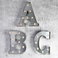 Industrial style decorative zinc letter decorations with carnival style lights…