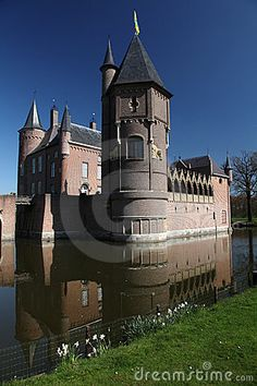 Old castle in a lake during springtime  *-*.