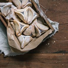 Traditionally served on the Jewish holiday Purim, these simple Hamantaschen cookies are made of a delicate cookie dough and are filled with poppy seed.