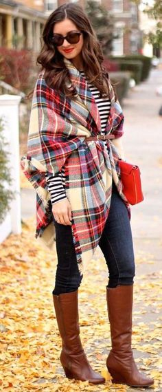how to style a plaid poncho : stripped top + jeans + bag + high boots