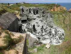 A view of the cliffs on May 6, 2014 in Pointe du Hoc, France. Overlay: After the assault at the cliffs of Pointe du Hoc by the 2nd Ranger Battalion (D, E and F Company) Colonel James E. Rudder establishes a Post Commando on June 1944.