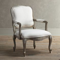 With French design influences and expertly hand-carved detailing, this arm chair brims with sophisticated style.