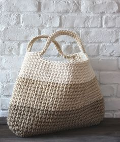 """crochet basket/bag..no pattern found just a great photo and inspiration..."" It is I love the colours including the painted brick wall S"