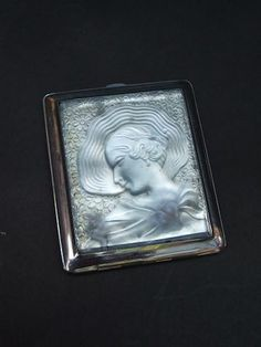 Rare blue tinted glass compact with a hatted deco lady to the lid.
