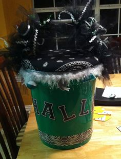 A cheer bucket! Can be used to hold poms, water or a snack.and can be used as a stool too. Like the fur and the football accents Cheer Coaches, Cheer Mom, Cheer Stuff, Cute Crafts, Crafts To Do, Cheer Buckets, Cheerleading Crafts, Cheer Pom Poms, Football Cheer