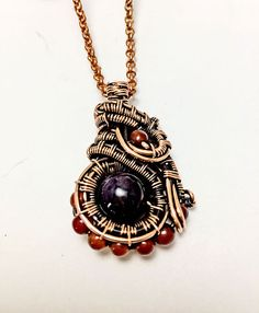 beautiful wire wrapped amethyst and carnelian stone pendant