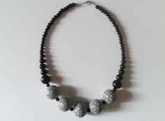 black polymer clay necklace with handmade beads decorated with geometric patterns