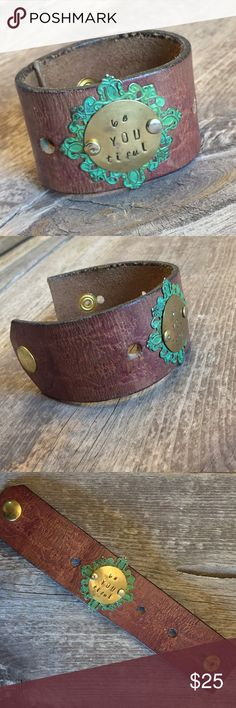 Hand Stamped Vintage Leather Cuff Bracelet beYOUtiful  Reminding you that you are beautiful just the way you are, this leather cuff is made from wide vintage leather with a lightly embossed floral pattern. Hand stamped lettering is attached on top of a colored metal filigree frame.  Each of these bracelets is one of a kind. These beautiful pieces make perfect gifts that are as unique as your loved ones.  This has one snap set to accommodate most wrists. I will gladly attach a second snap so…