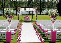 Good idea: durable outdoor wedding aisle runner made of Turf, comes with stakes to secure it - and comes in a lot of other colors as well