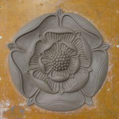 Tudor rose modelled in clay