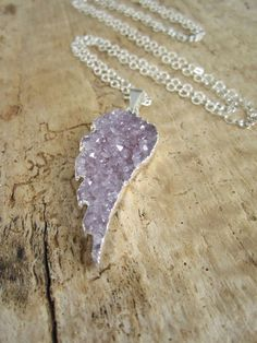 Necklace showcases a beautiful jasper quartz druzy angel wing pendant along a sterling silver cable chain. Gorgeous druzy pendant is a berry
