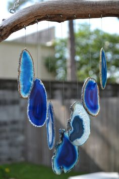 Driftwood & Agate Windchimes. These would be a stunning way to incorporate an oceanic feel in your home decor.
