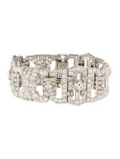 "French Art Deco Diamond Link Bracelet 18K white gold link bracelet featuring old European cut, single cut and baguette cut diamonds set in sculptural openwork stations with hidden box clasp closure, hinge and safety chain. 0.8"" high."