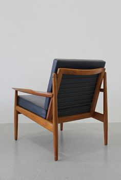Arne Vodder; Teak and Leather Armchair with Metal Back Supports for Glostrup, 1950s.