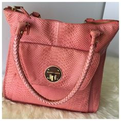 "Elliot Lucca leather bubblegum"" large tote This gorgeous Elliott Lucca leather bubblegum pink tote is perfect with a white off the shoulder tee and distressed ripped jeans . Features monogram buckle in zipper/ crocodile texture / Neutral floral polyester lining/ 100%  leather/ worn once, A little wear and discoloring but in excellent condition Elliott Lucca Bags Totes"