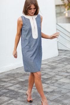 Emerson Fry - sleeveless blue chambray tunic with continuous white band around neck and front opening