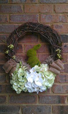 Easter Spring Wreath with Green White Hydrangeas Burlap Ribbon and Faux Moss Bunny via Etsy.