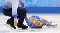 Andrea Davidovich and Evgeni Krasnopolski (ISR) of Israel compete in the pairs free skate figure skating competition at the Iceberg Skating Palace during the 2014 Winter Olympics, Wednesday, Feb. 12, 2014, in Sochi, Russia. (AP Photo/Vadim Ghirda)