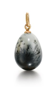 A Fabergé hardstone egg pendant, workmaster Feodor Afanassiev, St Petersburg, circa 1910. Carved of moss agate, gold loop.