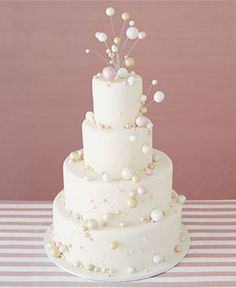 This toastworthy wedding cake is decorated with pearlized white-chocolate bubbles. The cake is made of airy genoise layered with vanilla-bean-and-Champagne-flavored mousseline creams