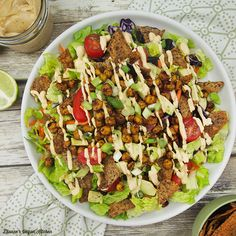 Taco Salad gets a tasty makeover with roasted chickpeas, creamy chipotle lime dressing, and Beanfields Pico de Gallo Rice and Bean Chips.