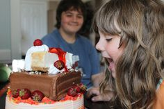 """I am grateful for my kids...even though there is a huge age gap, they are still so loving to one another...as my daughter tries to munch on my son's birthday cake!""    Michelle from Maine submitted 26 june, 2012"