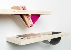 "Wooden shelves with soft, wool pockets making the obvious more interesting - ""Wall Shelves"" by Adam Janis"
