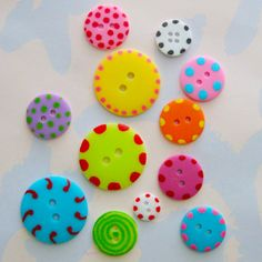 Hand-painted buttons.