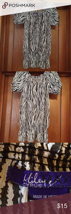 Miley Cyrus short sleeve top size L Miley Cyrus black & white animal print gathered neck and sleeves and bottom top size  L. Has tie closure around neck. Tops Blouses