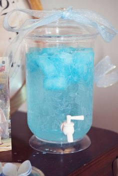 Sprite with frozen blue Hawaiian punch; Amazing drink for a FROZEN party.... And add some vodka for adult party!