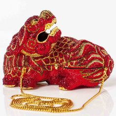 This is an authentic JUDITH LEIBER Swarovski Crystal Ming Dragon Minaudire Clutch.   This exquisite hard casing clutch is in the form of a Chinese dragon encrusted with bright Swarovski crystals.