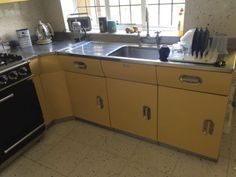 English-Rose-1950s-Aluminium-Fitted-Kitchen-in-Yellow-Sink-amp-corner-unit