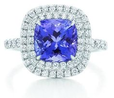 Tiffany and Co Soleste ring, with a cushion-cut tanzanite and a double row of round brilliant diamonds in platinum. Tanzanite, 8 mm wide. Diamonds, carat total weight .45.
