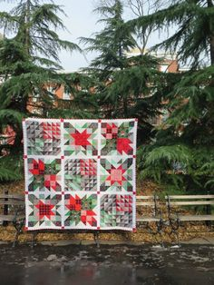 If you can stitch a quick half square triangle, you can make the Quick and Easy Christmas Quilt with your favorite holiday fabrics!