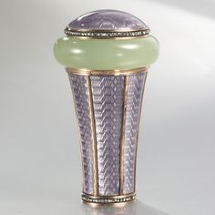 A FABERGÉ IMPERIAL GEM-SET BOWENITE, GOLD AND ENAMEL PARASOL HANDLE, WORKMASTER MICHAEL PERCHIN, ST. PETERSBURG, CIRCA 1895 the handle set with a carved, cushion-shaped piece of bowenite surmounted with a raised disk of lilac enamel over a wavy guilloché ground encircled by a band of rose diamonds, the collar with lilac enamel over a wavy guilloché ground with a series of bright-cut gold bands, with a gold band at the top and a rose diamond band at the bottom