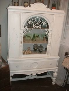 china cabinet as linen cabinet--upstairs bathroom