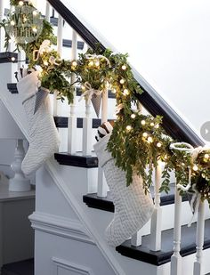 Festive staircase | white and black with twinkle lights and garland | beautiful!