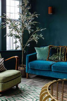 Dark & moody blue living room