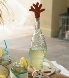 Use a wine cork or bottle stopper, and add 'coral' shaped out of clay :) I have that same glass fish bottle!