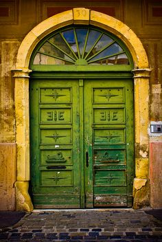 GREEN DOOR WITH YELLOW ARCH in BUDAPEST.  there is just something striking about this