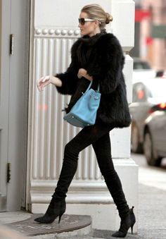 Fur coat, skinny jeans, ankle boots, sunnies and Hermes Birkin Blue Jean Togo bag - All black outfit with a pop of color by Rosie Huntington Whiteley