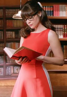 "Zooey Deschanel's Red and white colorblock dress on the Pantene ""Zooey's Day"" video.  Outfit details: http://wwzdw.com/z/4207/"