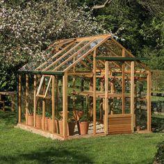 serre de jardin en verre et en bois, très élégante