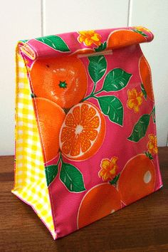 This reusable oilcloth lunch bag is an updated twist on the classic, brown-paper bag: water-resistant, flexible and oh so pretty.