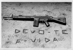 """Iconic! The PT army weapon, the Gewehr 3, German made, or aka G3 machine gun, on the ground and it says: """"i owe You my life""""."""