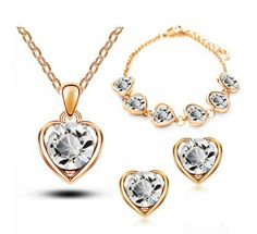 gold plated jewelry set heart-shaped Crystal earrings necklace bracelet 3 piece set wedding dress Jewelry Sets Fine or Fashion:Fashion is_customized:Yes Included Additional Item Description:set Style:Trendy Gender:Women Material:Crystal Occasion:Party Metals Type:Zinc Alloy Shape\pattern:Heart Jewelry Sets Type:Necklace/Earrings/Bracelet Model Number:Necklace bracelet sets