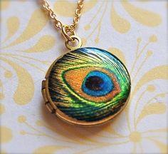 The Tiniest Peacock Feather Locket - Vintage $27.00    http://www.etsy.com/listing/53289021/the-tiniest-peacock-feather-locket