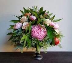 Our grand, fruited pedestal arrangement featuring stunning Peonies, Rosts and Pomegranates.